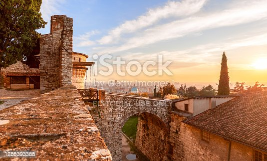 Brescia, Italy - October 28, 2020: Stunning sunset over Brescia city view from the old castle. Lombardy, Italy