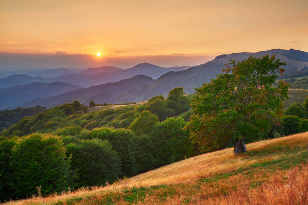 Stunning sunset over mountains relief. stock photo