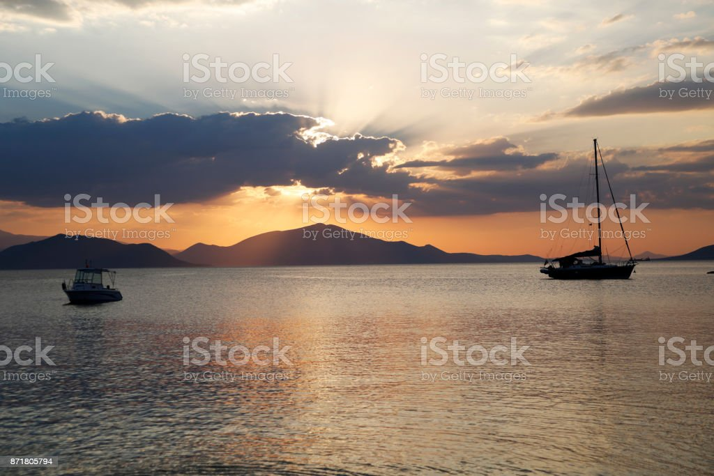 Stunning sunset over sea without filters stock photo