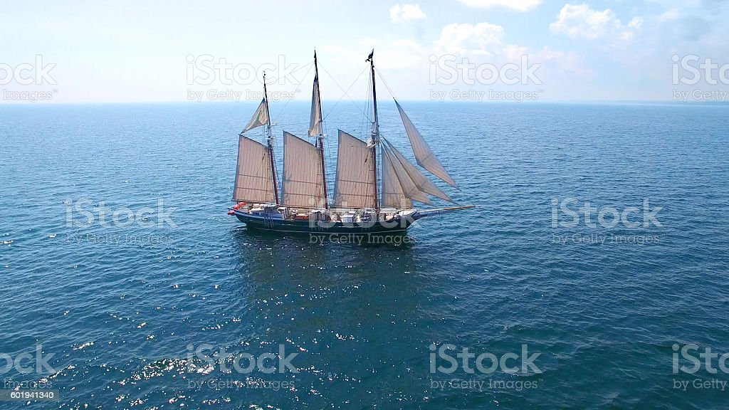 Stunning tall ship sailing calm waters stock photo