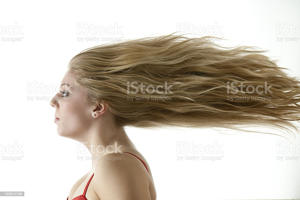 Stunning teenage girl with extreme blowing hair stock photo
