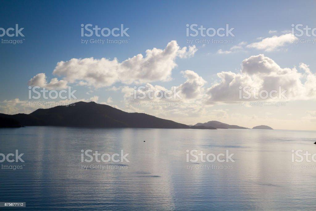 Stunning tropical island scene showing water and sun stock photo