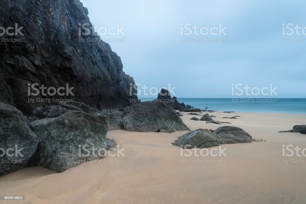 Stunning, vibrant sunrise landscape image of Barafundle Bay on Pembrokeshire Coast in Wales stock photo