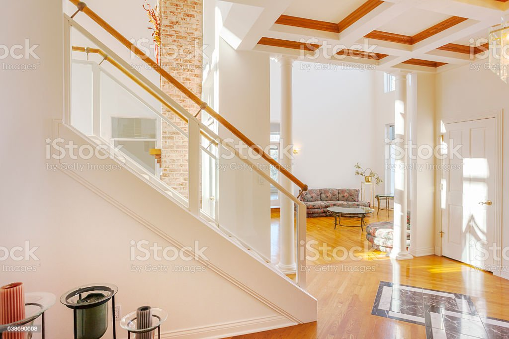Stunning view of bright home foyer with marble inlayed floor stock photo