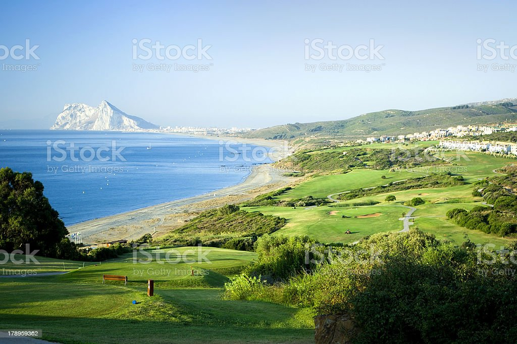 Stunning view of landscape with green land beach and ocean stock photo
