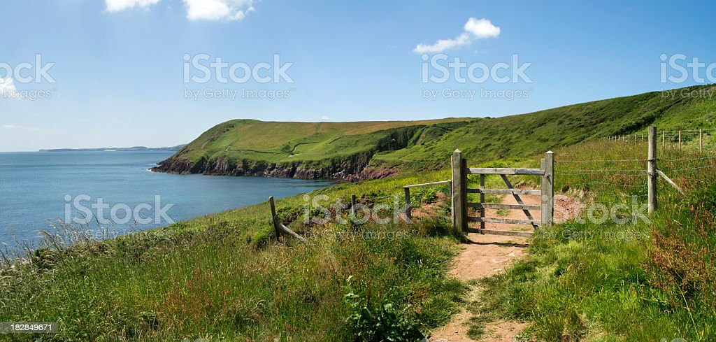 A stunning view of Pembrokeshire with the fence and a gate stock photo