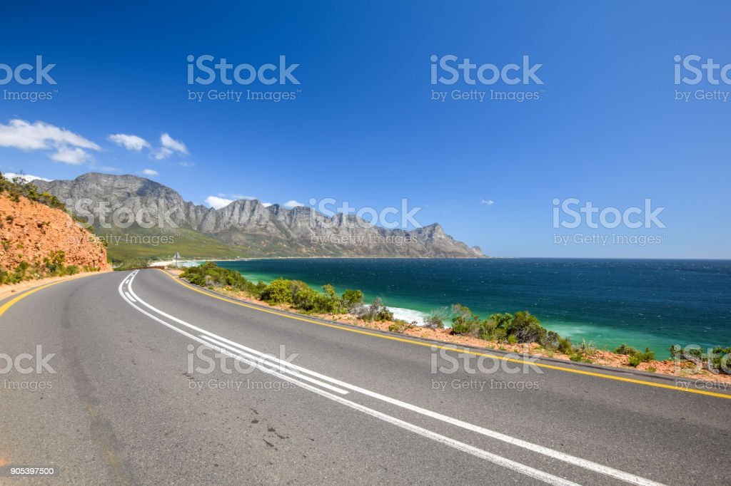 Stunning view of Route 44 near Kogel Bay Beach in the eastern part of False Bay near Cape Town between Gordon`s Bay and Pringle Bay. Hottentots Holland Mountain range in the background. stock photo
