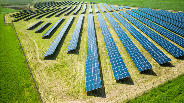 Stunning view of solar panels on green field in summer stock photo