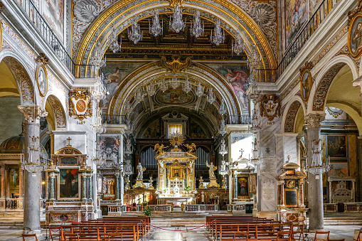 Rome, Italy, November 25 -- A stunning and detailed view of the central nave and the main altar inside the Basilica of Santa Maria in Aracoeli, site on the Capitoline Hill near Piazza del Campidoglio (Roman Capitol Square), in the historic heart of Rome. This church, built starting from the 6th century on the ruins of the Roman temple of Juno Moneta, has a predominantly Roman Gothic style with later Baroque interventions. According to legend, in this place the emperor Augustus had a vision of a woman with a child in her arms, identified as the Virgin Mary by a sibyl asked by the emperor. In 1980 the historic center of Rome was declared a World Heritage Site by Unesco. Image in high definition format.