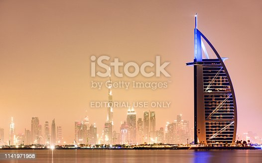 Dubai, United Arab Emirates, April 08, 2019. Stunning view of the illuminated Dubai skyline during sunset with the magnificent Burj Khalifa in the background and the seven stars luxury hotel Burj Al Arab in the foreground. Dubai, United Arab Emirates. Burj Al Arab It is the fourth largest hotel in the world.