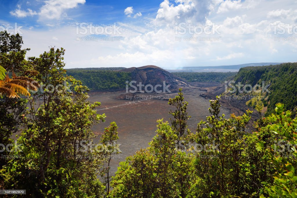 Stunning view of the Kilauea Iki volcano crater surface with crumbling lava rock in Volcanoes National Park in Big Island of Hawaii stock photo