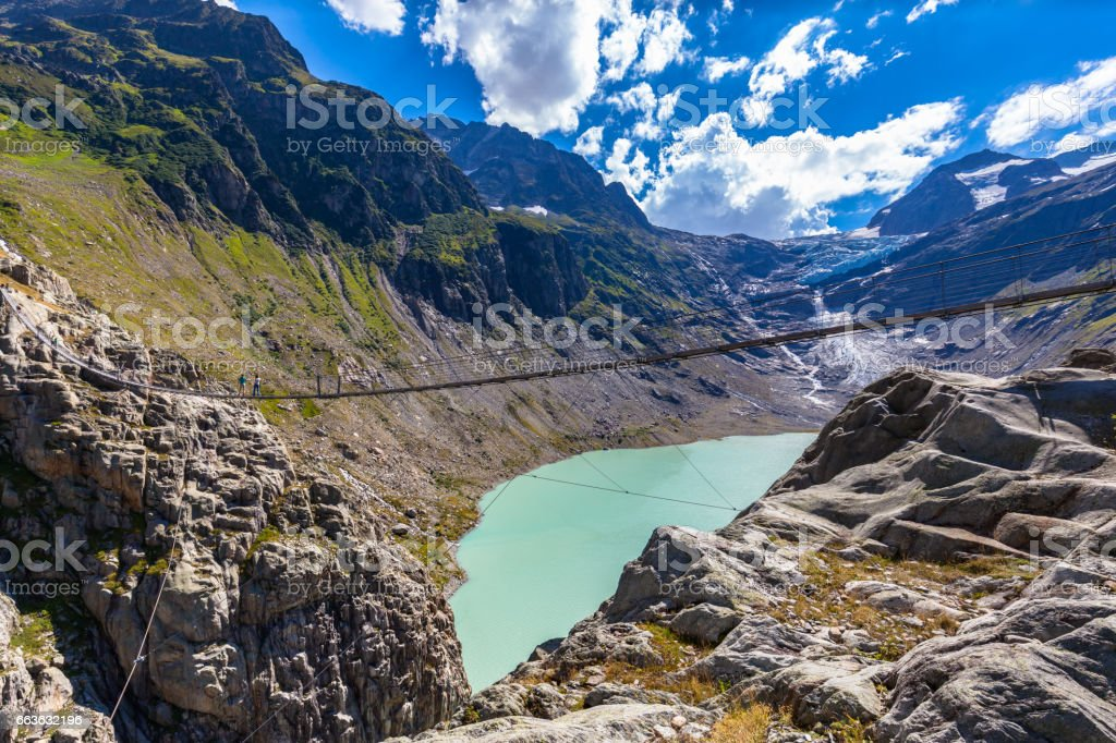 Stunning view of Trift bridge over the lake and glacier stock photo