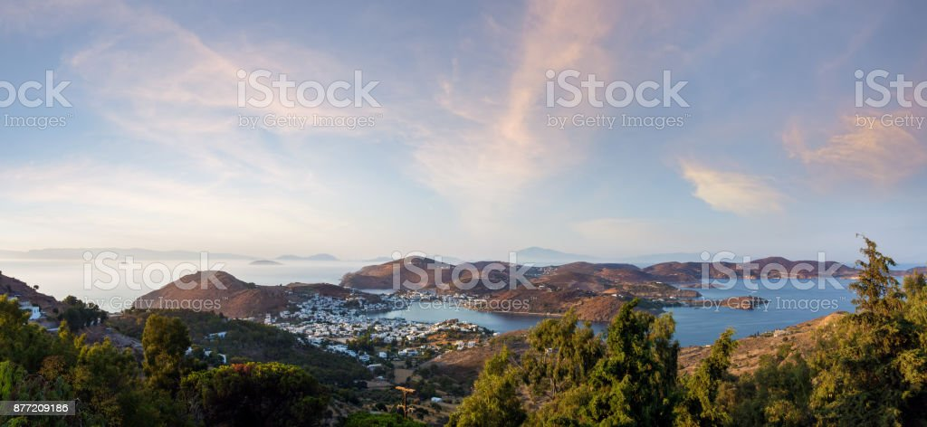 Stunning view to the sea from the chora of Patmos island, Greece, in the evening Stunning view to the sea from the chora of Patmos island, Greece, in the evening Architecture Stock Photo