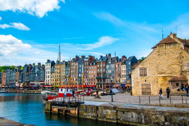 Stunning views of HonfluerThe Vieux-Bassin (old harbor) lined with 16th- to 18th-century townhouses Stunning clouds and colourful building of  honfleur Honfluer  france aHonfleur is a city in the department of Calvados, in northern France's  16th to !8th century calvados stock pictures, royalty-free photos & images