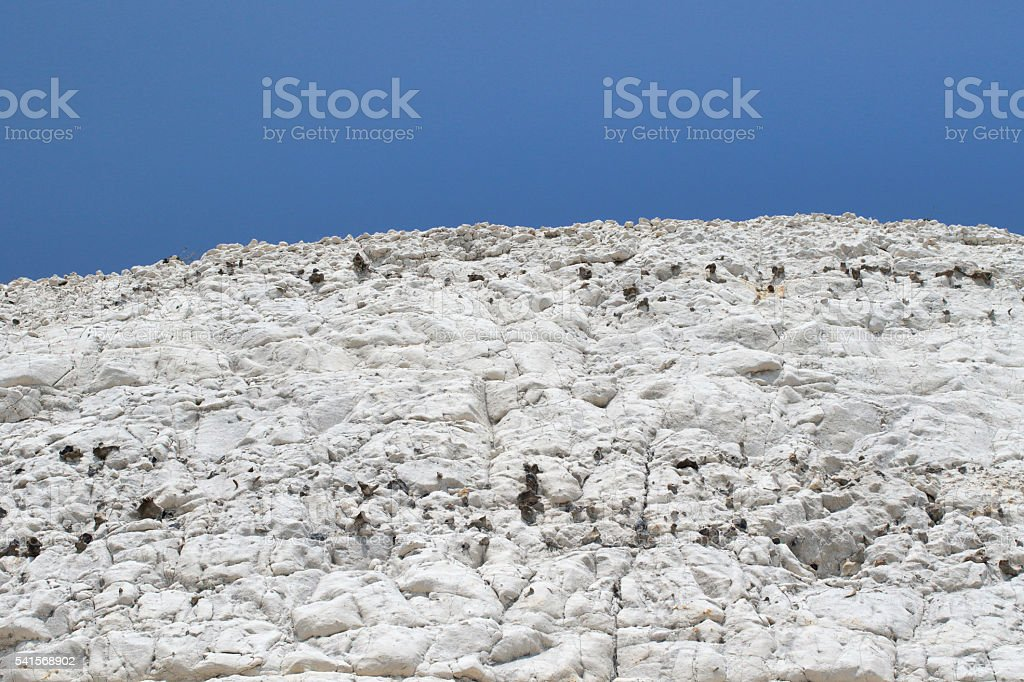 White chalk cliffs blue sky background copy space stock photo