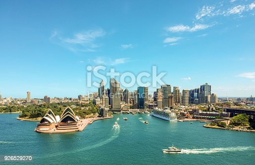 istock Stunning wide angle aerial drone view of the Sydney Harbour with the Opera House, a cruise ship and many skyscrapers in the background. Taken near the suburb of Kirribilli. New South Wales, Australia. 926529270