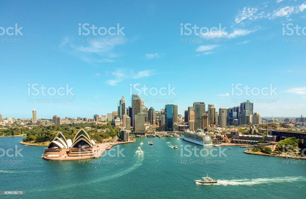 Stunning wide angle aerial drone view of the Sydney Harbour with the Opera House, a cruise ship and many skyscrapers in the background. Taken near the suburb of Kirribilli. New South Wales, Australia. stock photo