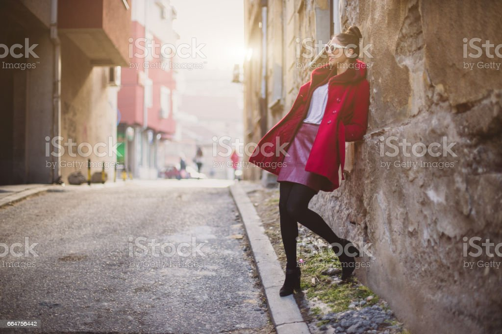 Stunning woman in the city street of an old town stock photo