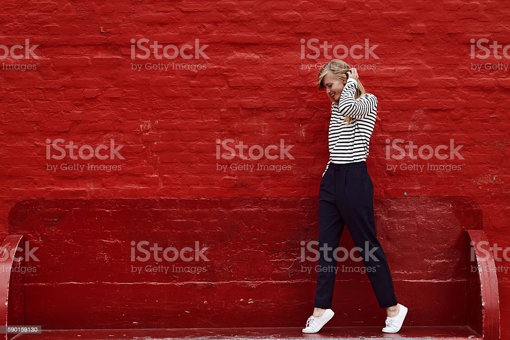 Stunning woman on red stock photo