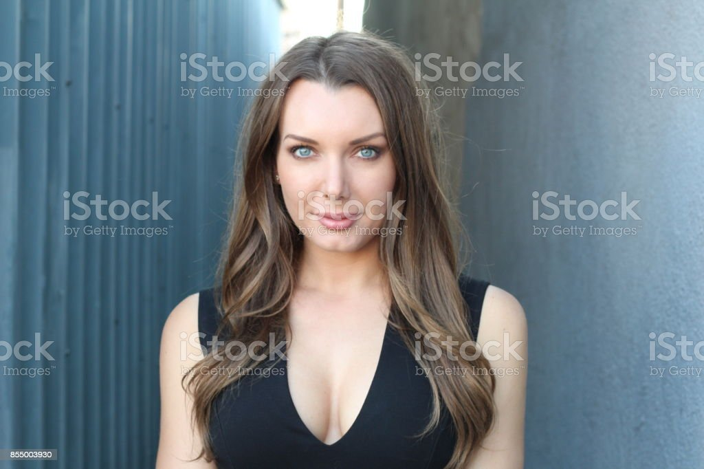 Stunning woman posing in black dress stock photo