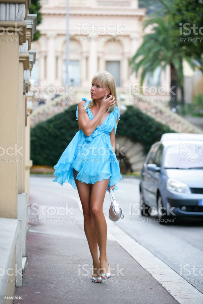 1fcbfe339f Stunning young woman in beautiful short blue barbie dress walking around in  Monte Carlo - Stock image .
