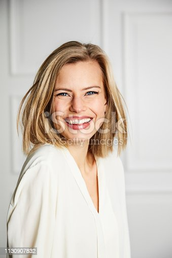 Stunning young woman smiling to camera