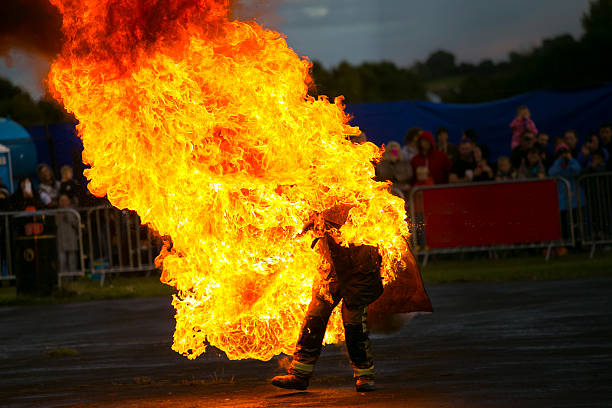 stunt man on fire - stock image - daredevil stock pictures, royalty-free photos & images