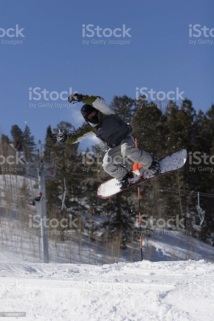 stunting snowboarder stock photo