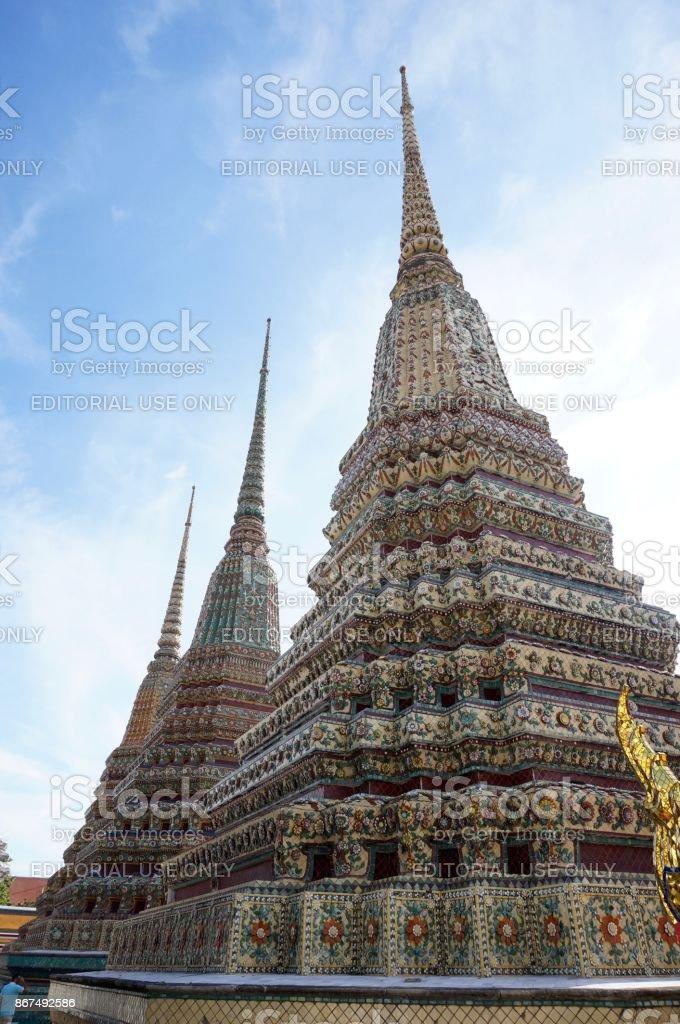 Stupa and statue at Wat Arun temple in Bangkok stock photo
