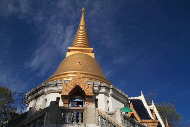 stupa at noon under blue sky Background