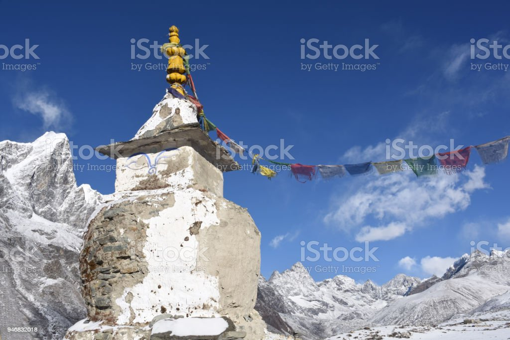 Stupa close to Dingboche, Nepal, and Cholatse Peak in the background stock photo