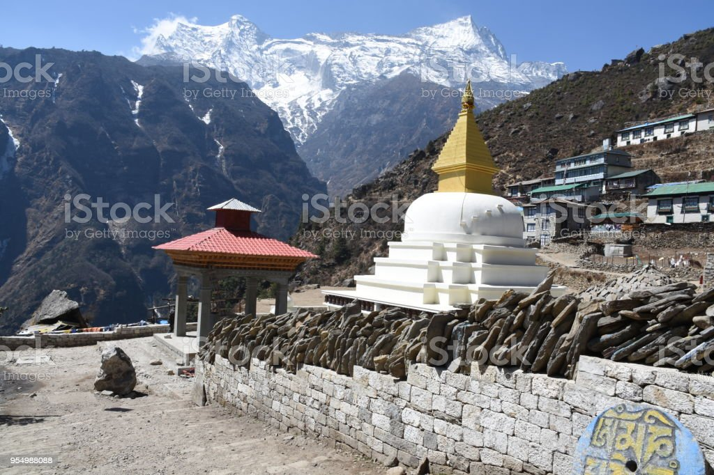 Stupa in Namche Bazaar and Kongde Ri in the background stock photo