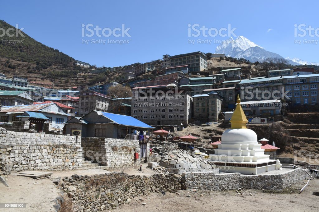 Stupa in Namche Bazaar and Mount Thamserku in the background stock photo