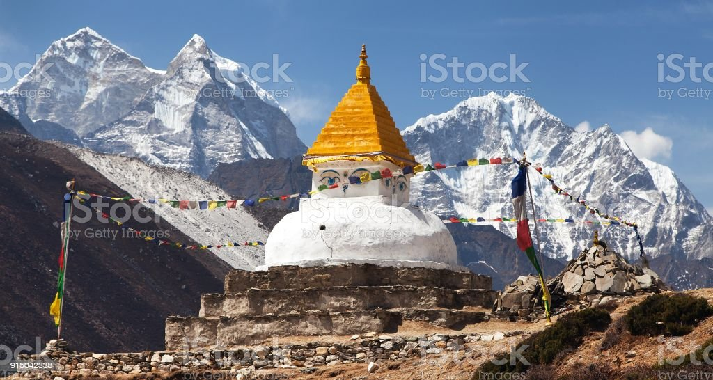 Stupa near Dingboche village with prayer flags stock photo