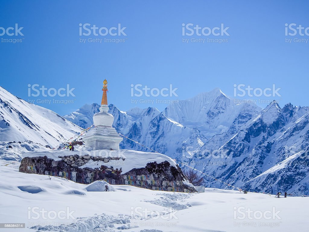 Stupa on the way to Kynjin Gompa on snow stock photo