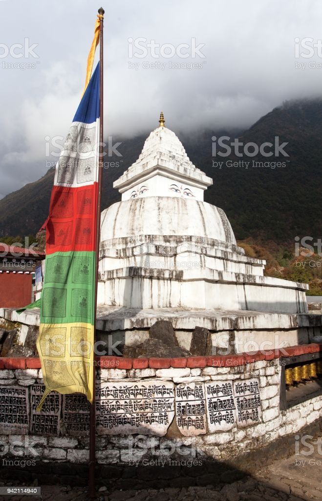Stupa with prayer flags and wheelsin stock photo