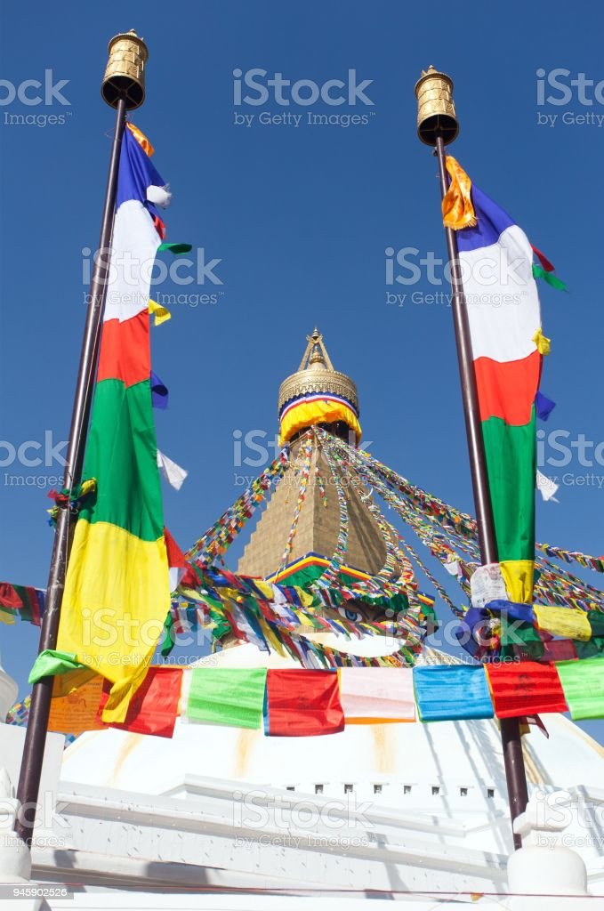 stupa with prayer flags stock photo