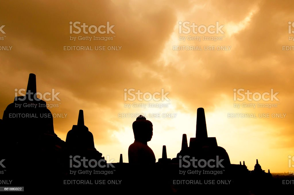 Stupas and Statue of Buddha at Borobudur Temple, Yogjakarta Indonesia. stock photo