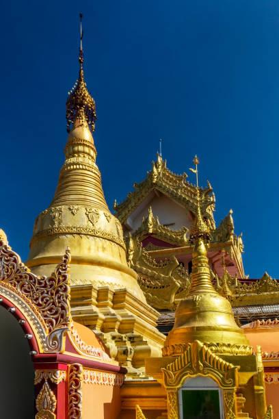 Stupas of Dhammikarama Burmese Temple in Georgetown of Penang in Malaysia. Vertical view. stock photo
