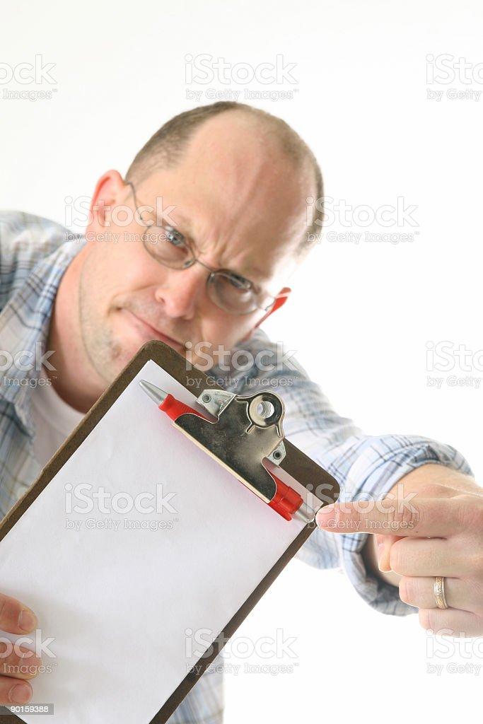 Stupid Man Holding Blank Clipboard royalty-free stock photo