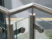 Sturdy silver metal handrail with glass in between