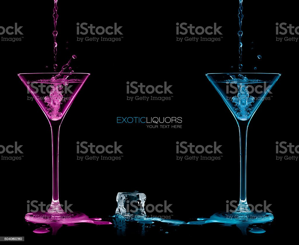 Style and Celebration Concept. Two Cocktail Glasses with Colorful liquor stock photo