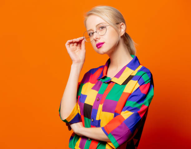 Style blonde in 90s shirt and glasses stock photo