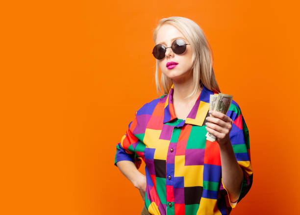 Style blonde in 90s shirt with dollars stock photo