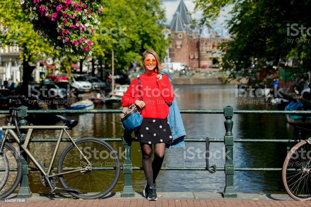 Style girl in sunglasses in Amsterdam stock photo