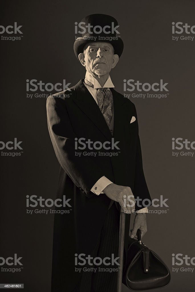 1900 style man wearing black hat and coat. stock photo