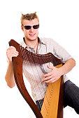 style man with harp closeup shot