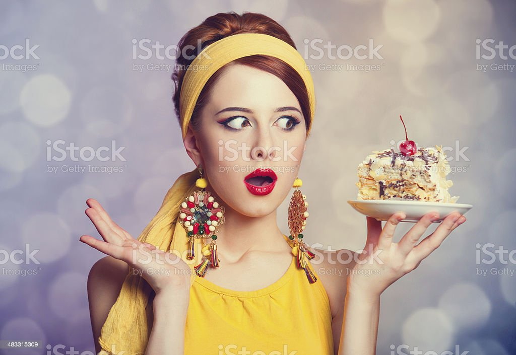Style redhead girl with cake. royalty-free stock photo