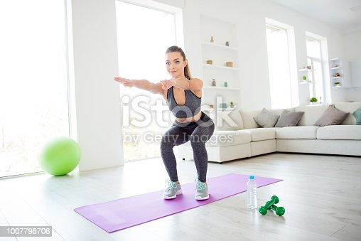 istock Style vitality beautiful figure healthy soul and body concept. Photo portrait of beautiful pretty charming lovely focused confident lady sportive shoes tight leggings doing squat against loft window 1007798706