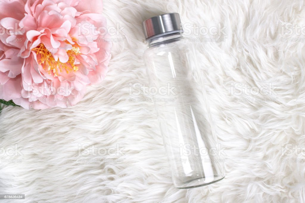 Styled mockup of clear plain glass water bottle. stock photo